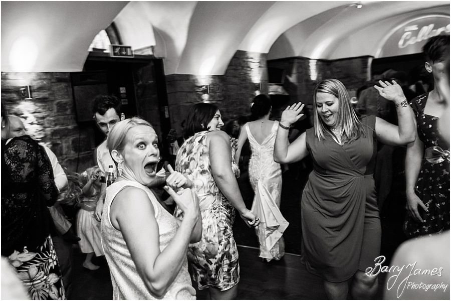 Photographs that capture the fun of the wedding party in the cellar at Clearwell Castle in Gloucestershire by Gloucester Wedding Photographer Barry James