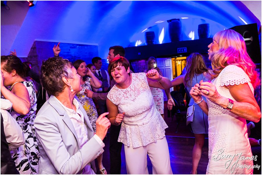 Candid photographs of the fun evening party at Clearwell Castle in Gloucestershire by Gloucester Wedding Photographer Barry James