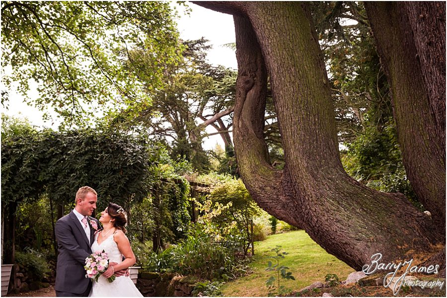 Creative and relaxed photographs of the bride and groom around the grounds at Hawkesyard Estate in Rugeley by Rugeley Wedding Photographer Barry James