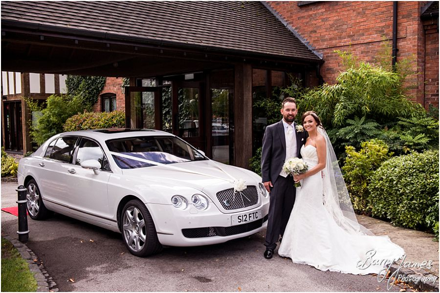 Beautiful wedding transport from Finishing Touch Cars at The Moat House in Acton Trussell by West Midlands Wedding Photographer Barry James