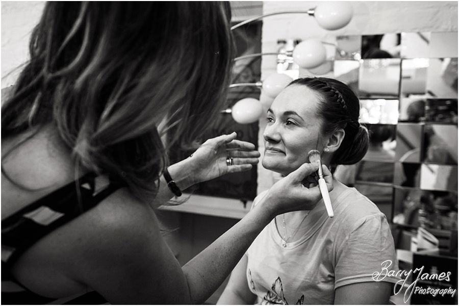 Creative candid photographs of the bridal preparations at Netherstowe House in Lichfield by Lichfield Wedding Photographer Barry James