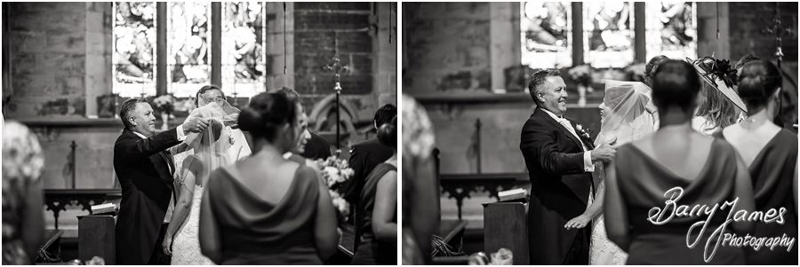 Beautiful photographs of the emotional entrance of the bride at St John the Baptist in Armitage by Rugeley Wedding Photographer Barry James