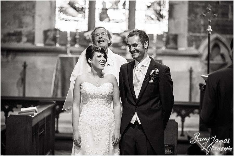 Unobtrusive photographers capturing the wedding ceremony at St John the Baptist in Armitage by Rugeley Wedding Photographer Barry James
