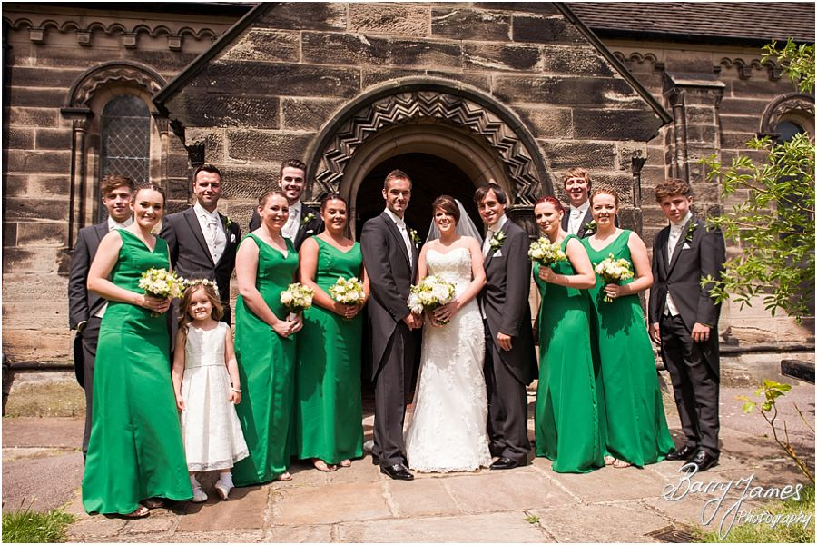 Relaxed traditional family photos at church at St John the Baptist in Armitage by Rugeley Wedding Photographer Barry James