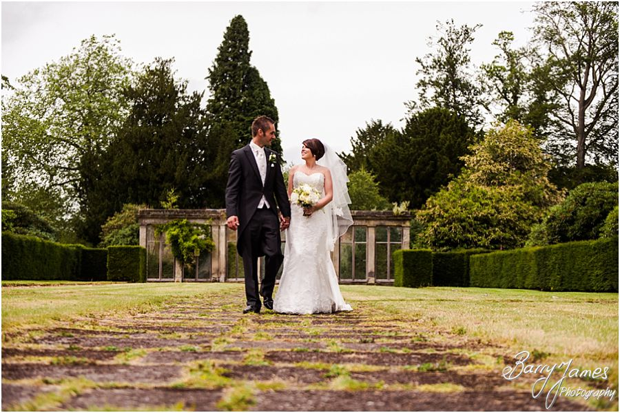 Creative portraits around the wonderful gardens of Sandon Hall in Staffordshire by Recommended Wedding Photographer Barry James