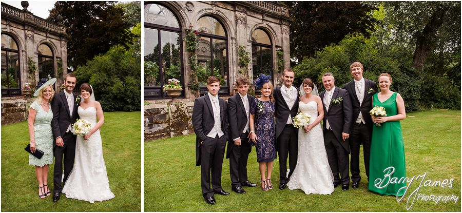 Natural family photos on the lawn at Sandon Hall in Staffordshire by Recommended Wedding Photographer Barry James