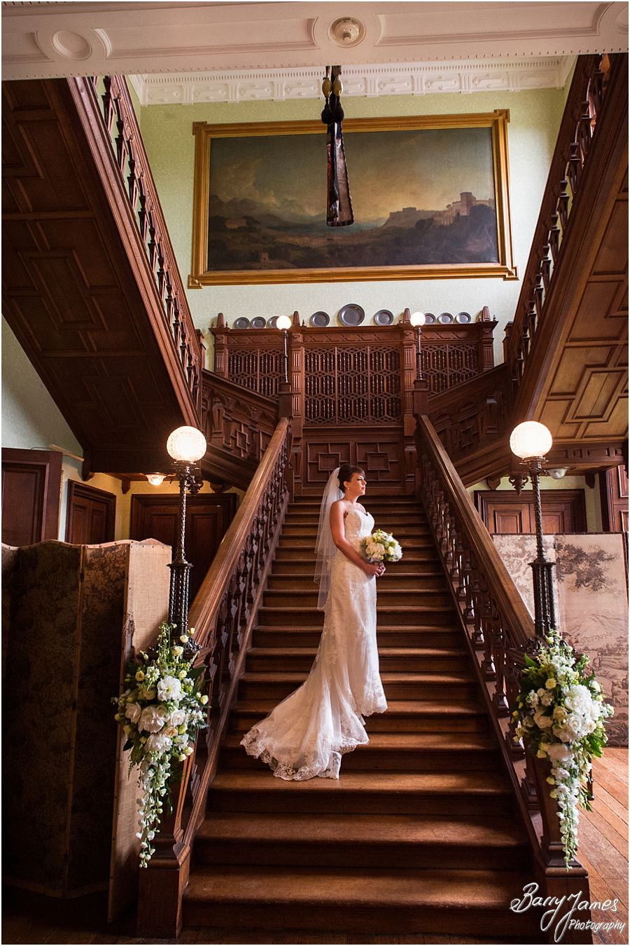 Timeless portraits on the staircase at Sandon Hall in Staffordshire by Recommended Wedding Photographer Barry James