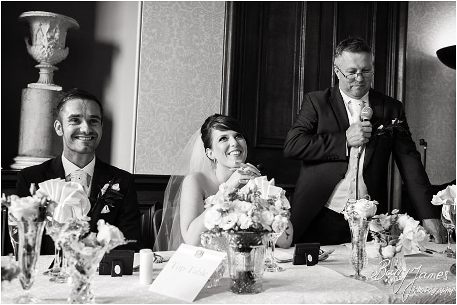 Candid photos of the Father of the Brides speech with wonderful reactions from the bridal party at Sandon Hall in Staffordshire by Recommended Wedding Photographer Barry James