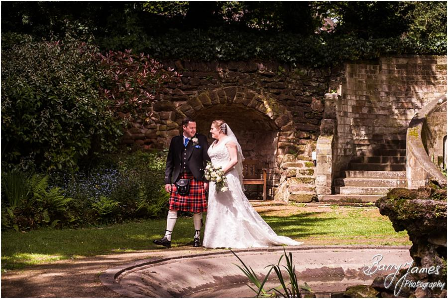 Contemporary portraits of the bride and groom in the beautiful gardens at Moor Hall in Sutton Coldfield by Sutton Coldfield Wedding Photographer Barry James