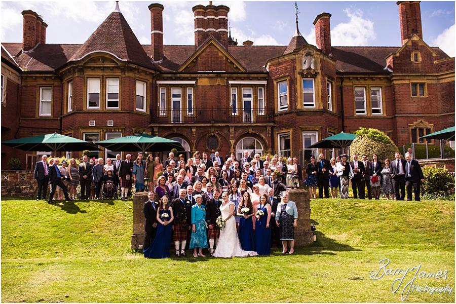 Family group photographs on the rear steps at Moor Hall in Sutton Coldfield by Sutton Coldfield Wedding Photographer Barry James