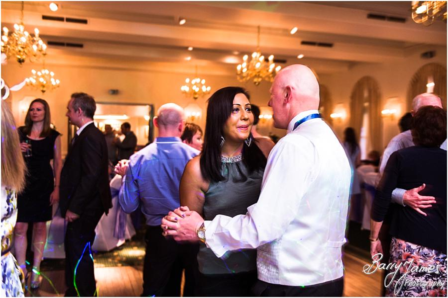 Creative candid photographs that show the fun of the evening reception at Moor Hall in Sutton Coldfield by Sutton Coldfield Wedding Photographer Barry James