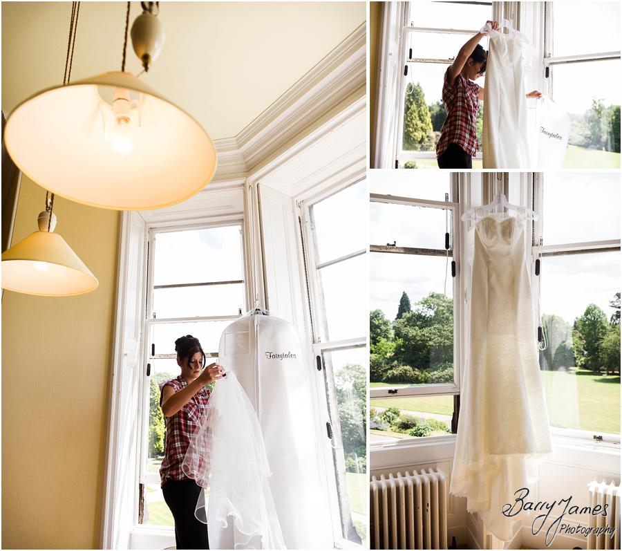 Candid photographs of the bridal preparations at Sandon Hall in Stafford by Stafford Wedding Photographer Barry James