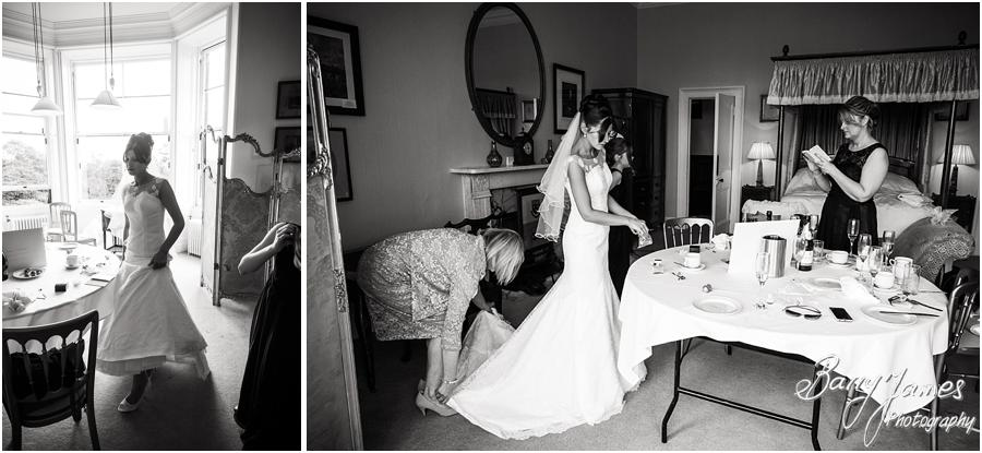 Unobtrusive candid photos of the bridal dressing in her gown at Sandon Hall in Stafford by Stafford Wedding Photographer Barry James