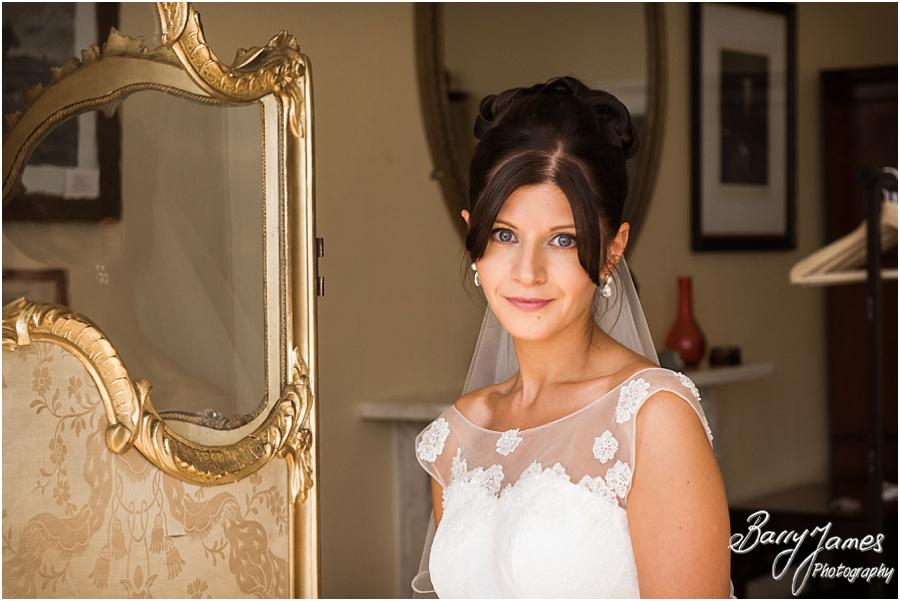Elegant bridal portraits in the beautiful bedroom at Sandon Hall in Stafford by Stafford Wedding Photographer Barry James