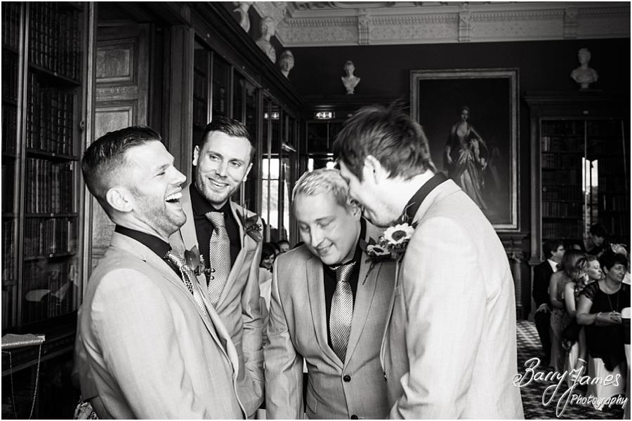 Groomsmen share a nervous laugh waiting for the brides arrival at Sandon Hall in Stafford by Stafford Wedding Photographer Barry James