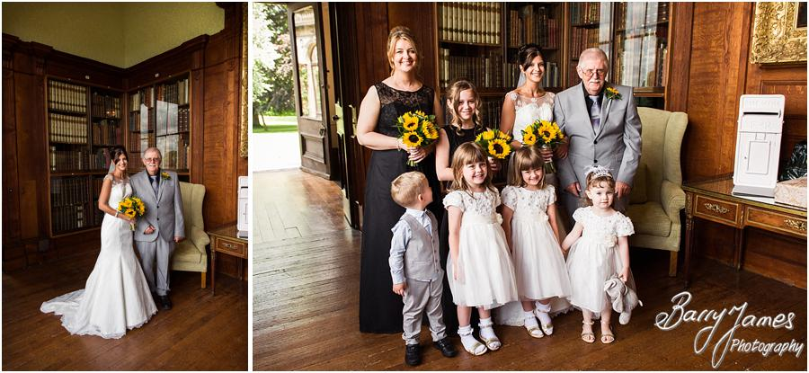 Capturing the entrance of the beautiful bride to the wedding ceremony in the Library at Sandon Hall in Stafford by Stafford Wedding Photographer Barry James