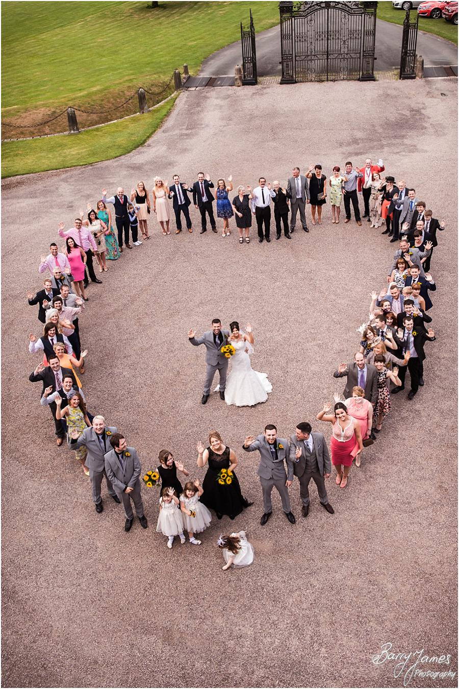 Creative heart shaped big group at Sandon Hall in Stafford by Stafford Wedding Photographer Barry James