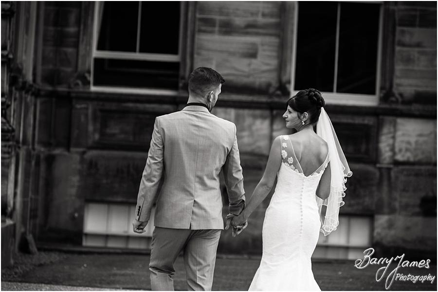 Beautiful portraits on the front of Sandon Hall in Stafford by Stafford Wedding Photographer Barry James