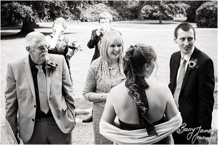 Candid photographs of the guests enjoying the wonderful setting for the drinks reception at Sandon Hall in Stafford by Stafford Wedding Photographer Barry James