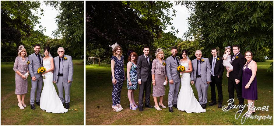 Contemporary relaxed family photographs on the lawns at Sandon Hall in Stafford by Stafford Wedding Photographer Barry James