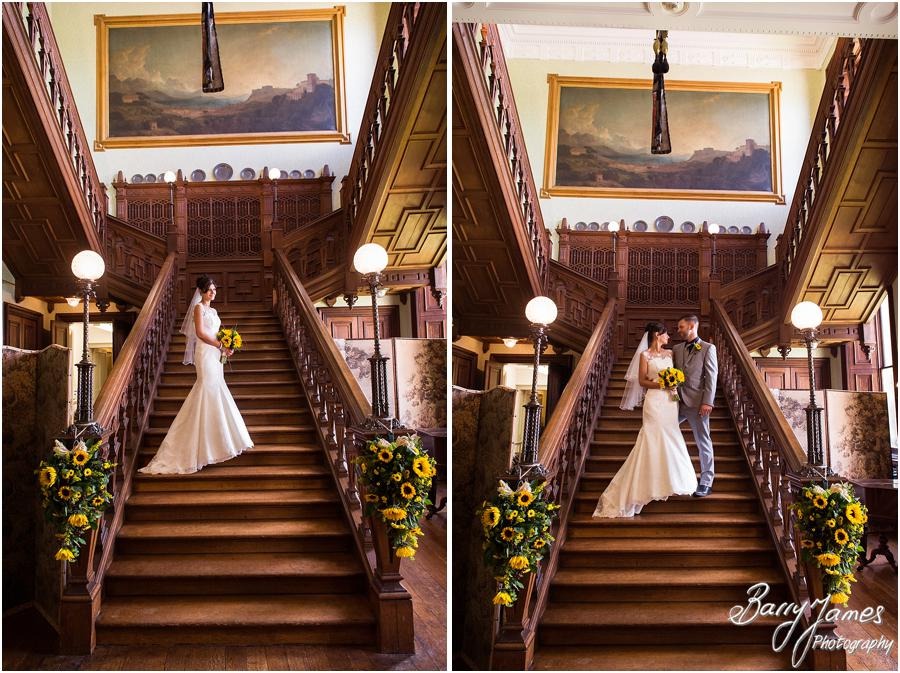 Creative portraits on the beautiful staircase at Sandon Hall in Stafford by Stafford Wedding Photographer Barry James