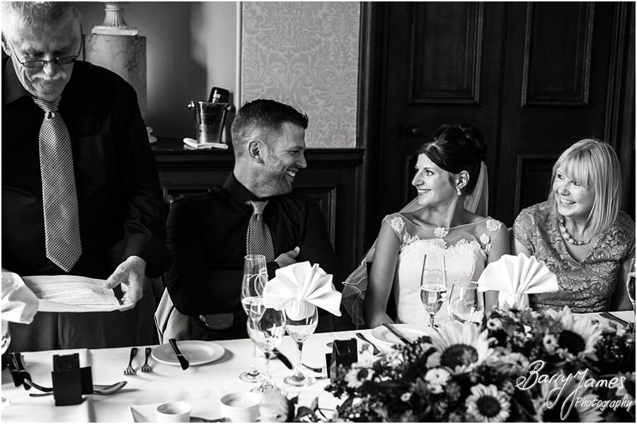 Creative candid photographs that capture the Father of the Bride's speech perfectly at Sandon Hall in Stafford by Stafford Wedding Photographer Barry James