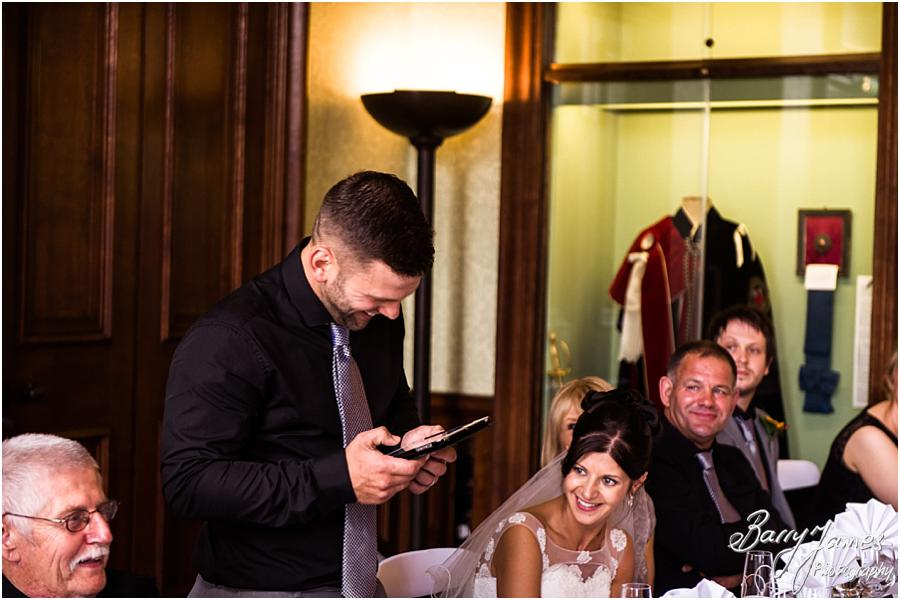 Unobtrusive candid photographs that show the emotion and reaction to the Grooms wedding speech at Sandon Hall in Stafford by Stafford Wedding Photographer Barry James