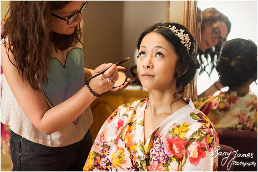 Creative candid photos of the bridal preparation before the wedding at Sandon Hall in Stafford by Stafford Wedding Photographer Barry James