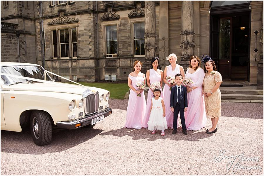 Capturing the arrival of the bridesmaids in the beautiful wedding cars at Sandon Hall in Stafford by Stafford Wedding Photographer Barry James