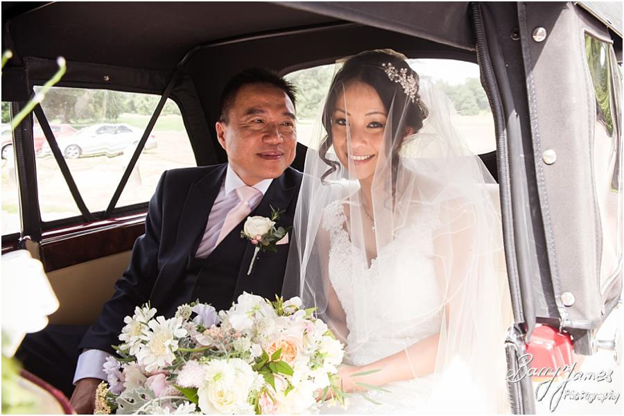 Creative natural photos that capture the arrival of the beaming bride and her father at Sandon Hall in Stafford by Stafford Wedding Photographer Barry James