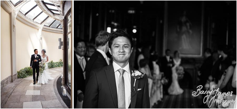 Nervous anticipation for the waiting groom for his bride at Sandon Hall in Stafford by Stafford Wedding Photographer Barry James