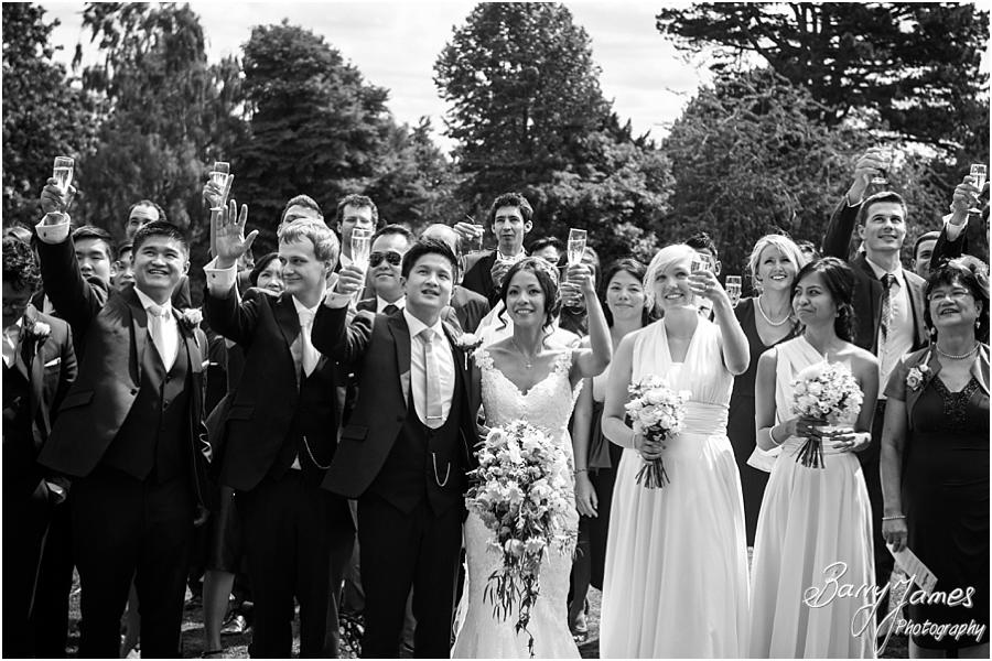 Fabulous family group photograph on the back lawn at Sandon Hall in Stafford by Stafford Wedding Photographer Barry James