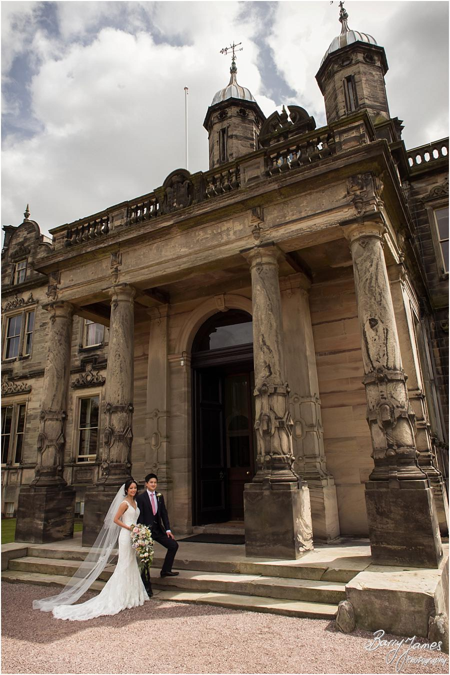 Contemporary portraits of the Bride and Groom at Sandon Hall in Stafford by Stafford Wedding Photographer Barry James
