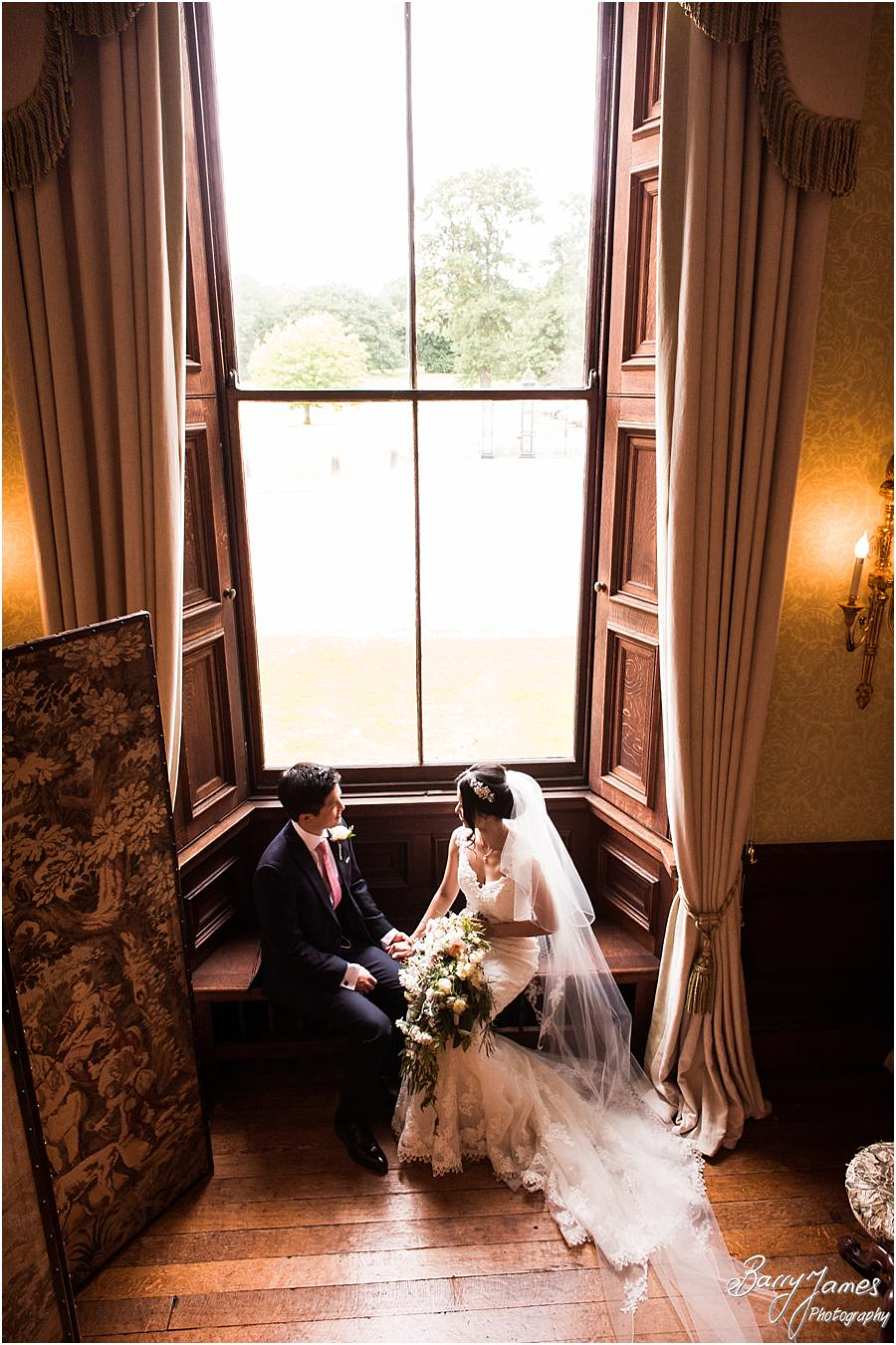 Creative portraits on the grand staircase at Sandon Hall in Stafford by Stafford Wedding Photographer Barry James