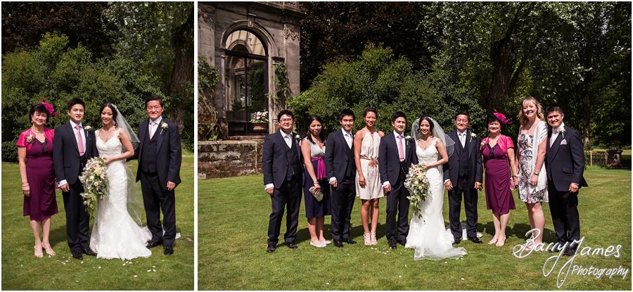 Relaxed family group photographs in the gardens at Sandon Hall in Stafford by Stafford Wedding Photographer Barry James
