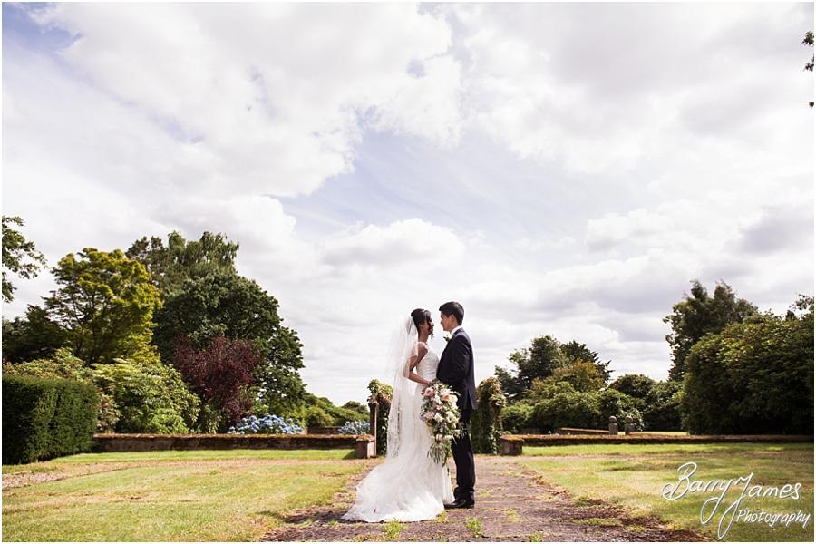 Creative natural portraits of the couple around the stunning setting of Sandon Hall in Stafford by Stafford Wedding Photographer Barry James