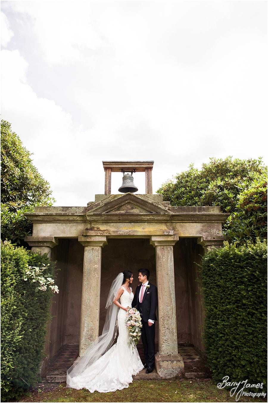 Elegant and natural photographs of the bride and groom around the gardens at Sandon Hall in Stafford by Stafford Wedding Photographer Barry James