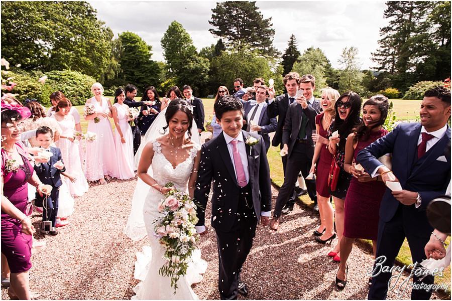 Confetti fun at Sandon Hall in Stafford by Stafford Wedding Photographer Barry James
