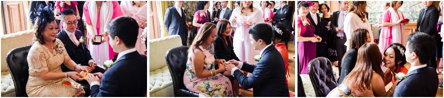 Creative candid photographs of the Chinese tea ceremony at Sandon Hall in Stafford by Stafford Wedding Photographer Barry James