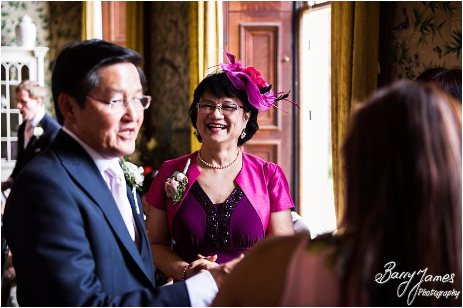 Candid photographs of the guests enjoying the drinks reception at Sandon Hall in Stafford by Stafford Wedding Photographer Barry James