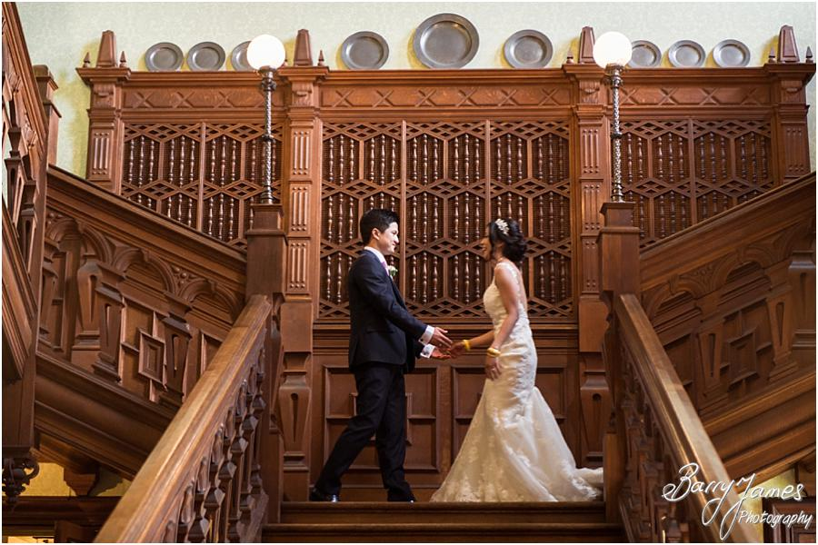 Capturing the fabulous entrance down the grand entrance at Sandon Hall in Stafford by Stafford Wedding Photographer Barry James