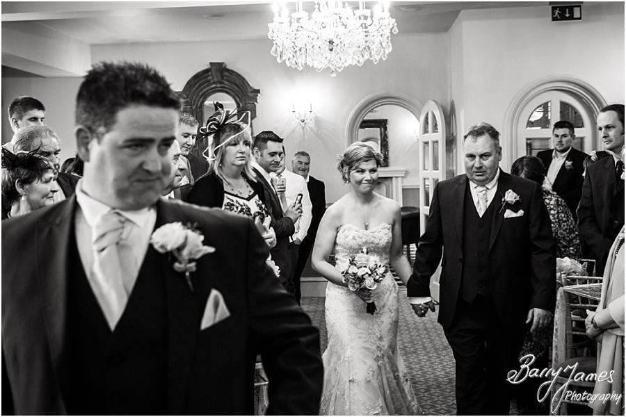 Candid photographs of the nervous groom and entrance of the beautiful bride at Weston Hall in Stafford by Stafford Wedding Photographer Barry James