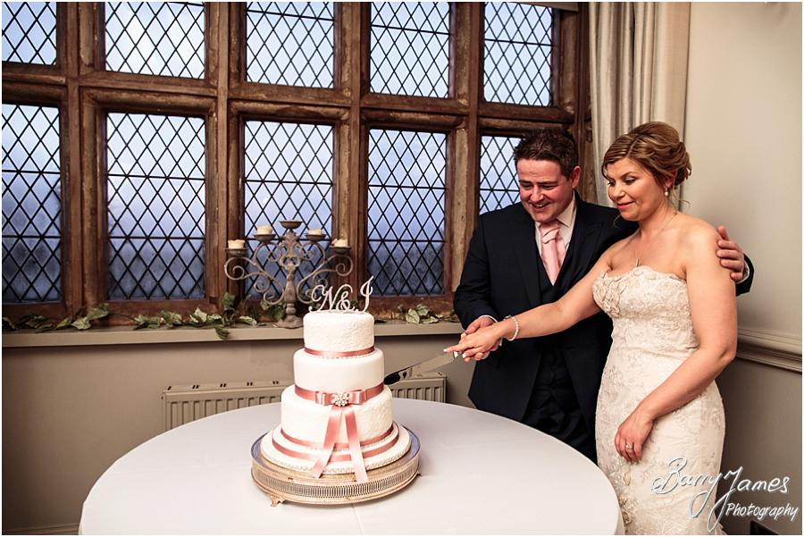 Cake cutting fun at Weston Hall in Stafford by Stafford Wedding Photographer Barry James