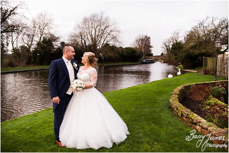 Beautiful photos on the canalside at The Moat House in Acton Trussell by Stafford Wedding Photographer Barry James
