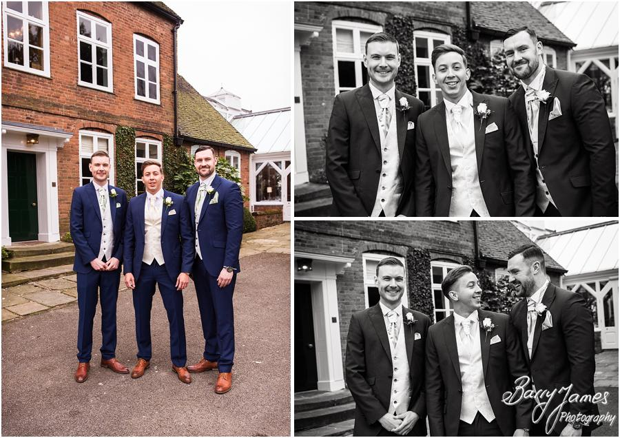 Relaxed natural portraits of the Groomsmen with the Moat House as the backdrop