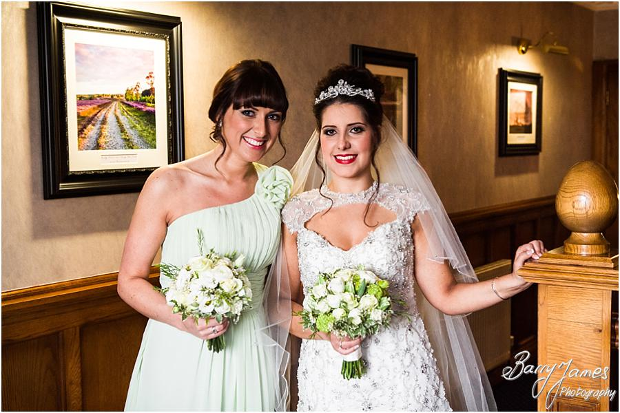 Natural contemporary portraits of the Bride and her party on the landing at The Moat House