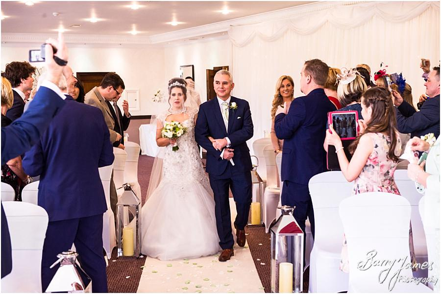 Candid photographs of the beautiful entrance of the bride to the Acton Suite